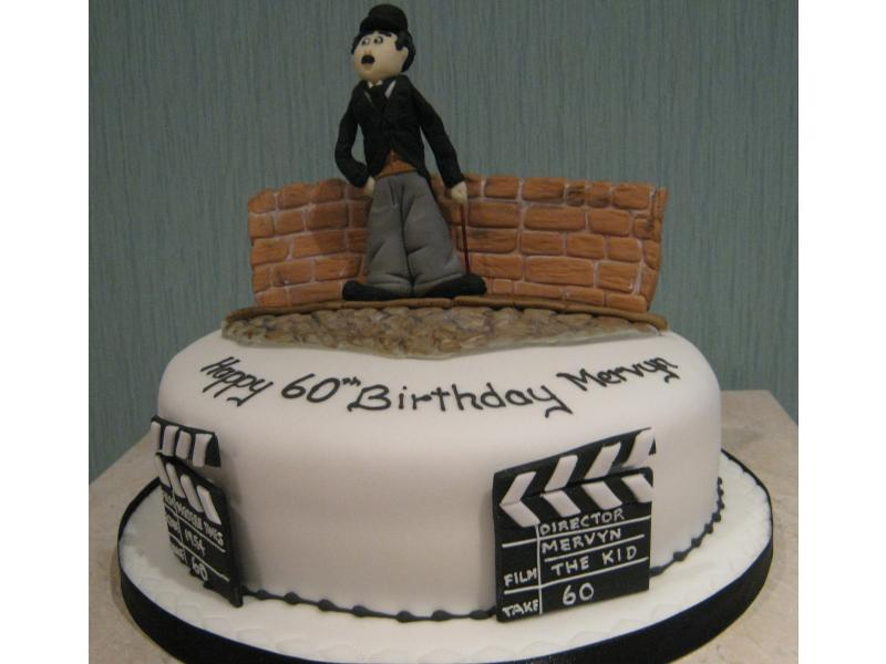 Charlie Chaplin model on Madeira sponge cake for Mervyn's 60th birthday in Freckleton