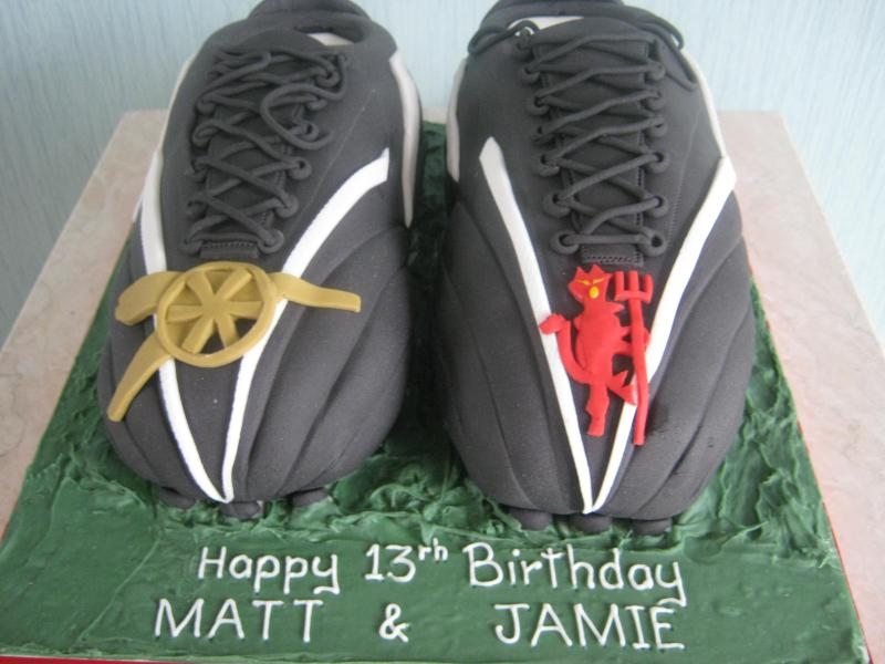 Arsenal and Man.Utd football boots for twin's 13th birthday in Lytham made from chocolate and vanilla sponges.