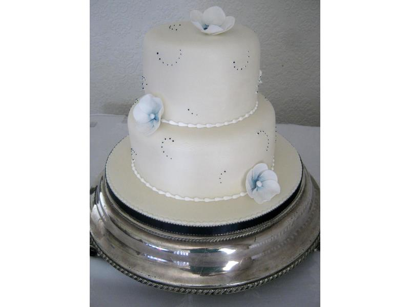 Sarah - Mother of Pearl with white flowers, dusetd in navy Wedding Cake at Ribby Hall