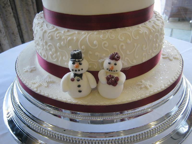 Burgandy wedding Cake -close up to show the Winter themed decorations