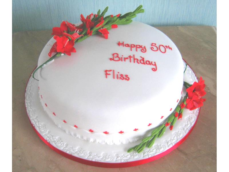 Gladioli on 50th birthday cake in chocolate sponge for Fliss celebrating at Green Drive Golf Club Lytham