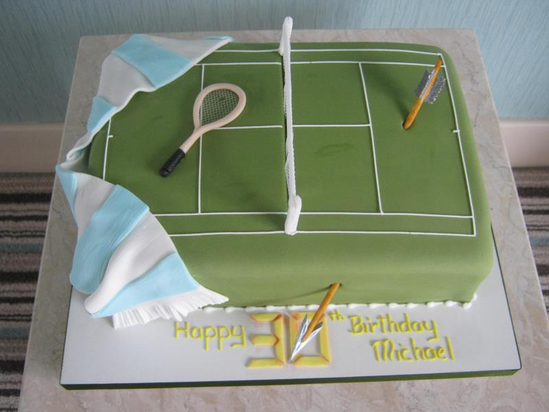 Sport themed cake for Man City fan who is also into tennis and Arrow, made from vanilla sponge.