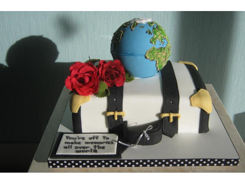 Emigrating and holidays themed, incorporating suitcase and globe in vanilla sponge Lytham St Annes