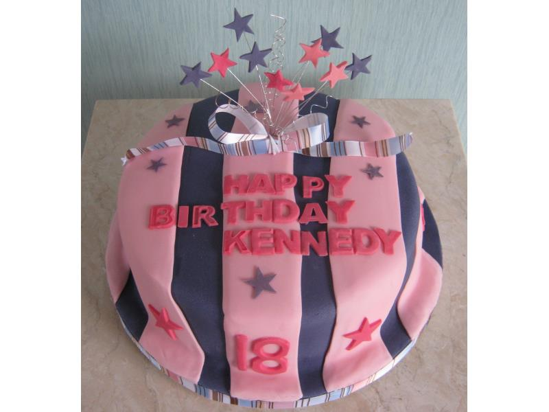 Kennedy celebrating 18th birthday in Fleetwood, starburst with pink and purple stripes in plain sponge