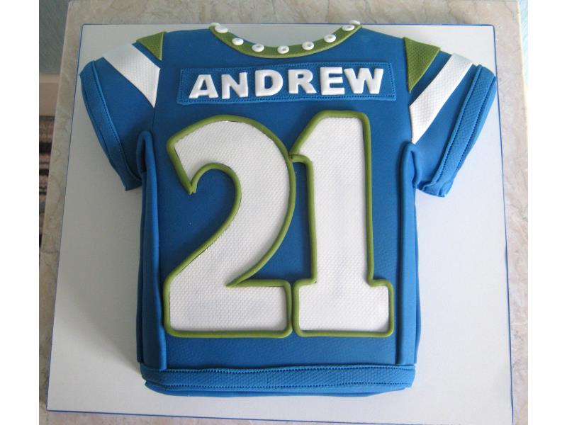 Andrew- blue and yellow football shirt from chocolate sponge for his birthday