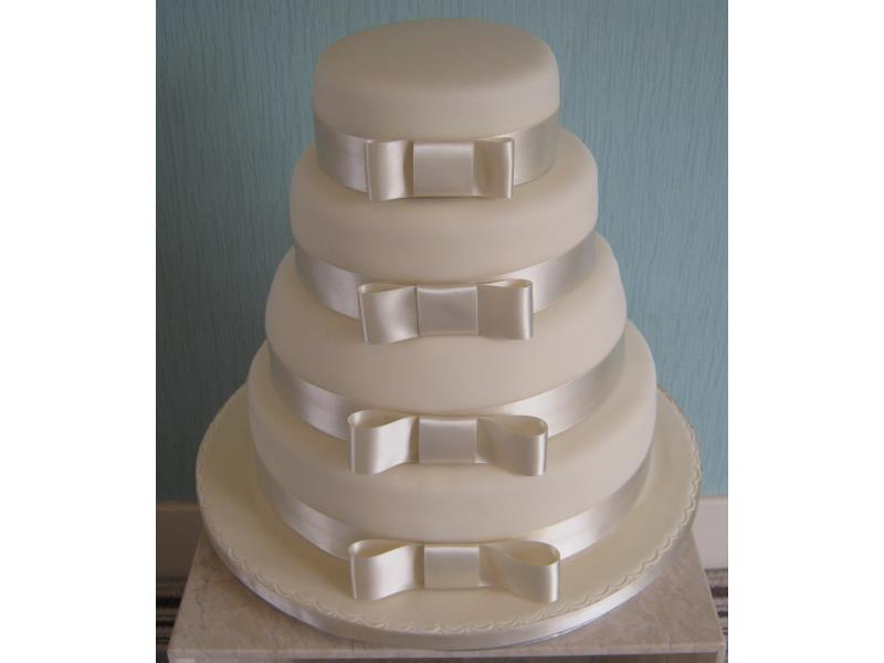 Ivory wedding cake in chocolate, vanilla and chocolate with orange sponges in Yorkshire