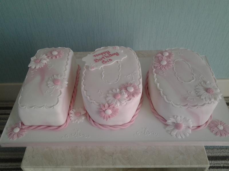 Cis - 100th birthday cake in pink marbled icing in Madeira for lady in Lytham