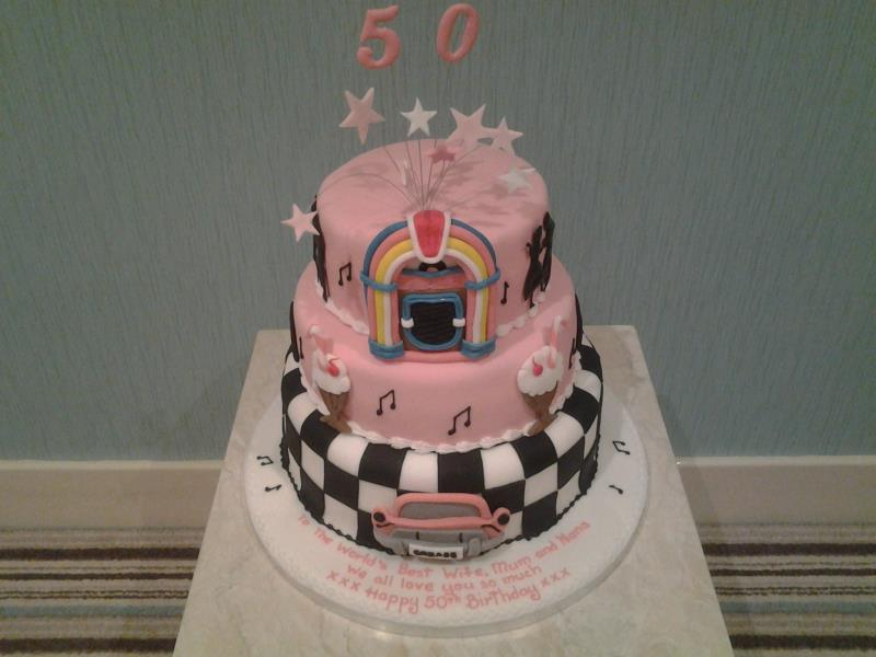 50s themed cake in pink with jukebox for Natalie's suprise 50th birthday party at North Shore Golf Club, Bispham. Made from Madeira and choc sponges.