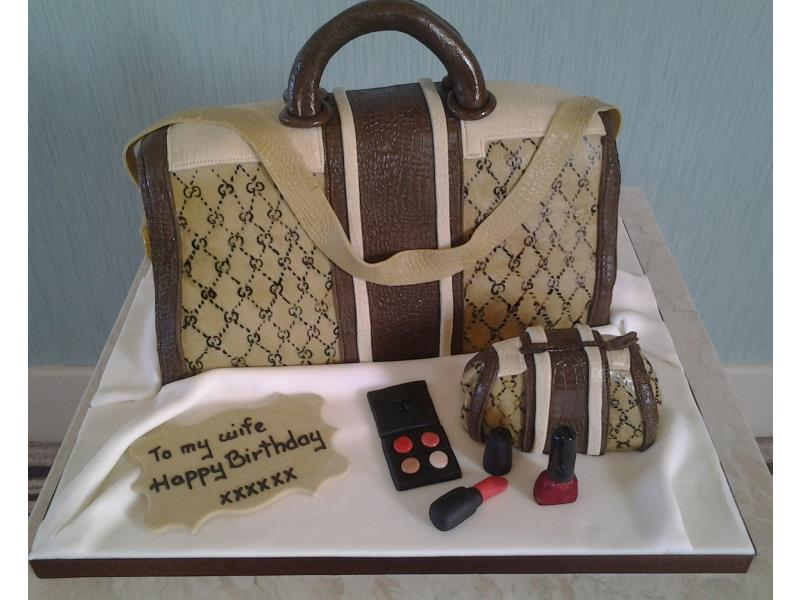 Gucci Handbag with makeup in plain sponge for wife's birthday in Lancaster