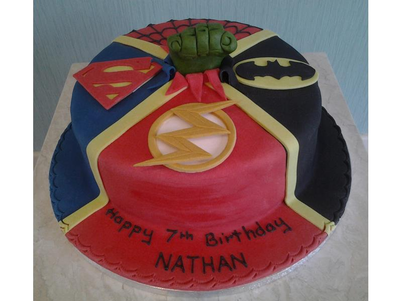 Superman and Batman logos made to Nathan's own design for his birthday in Blackpool. Made from plain sponge