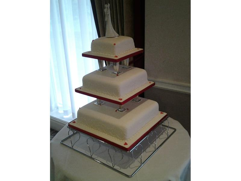 Sharon - 3 tier wedding cake with pillars in white and red for Sharon & James in Rochdale, made from fruit cake and chocolate sponge