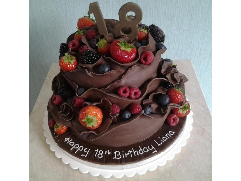 Chocolate cake with fresh fruit, made from chocolate sponge  and coated in chocolate sugarpaste for Liana in Staining