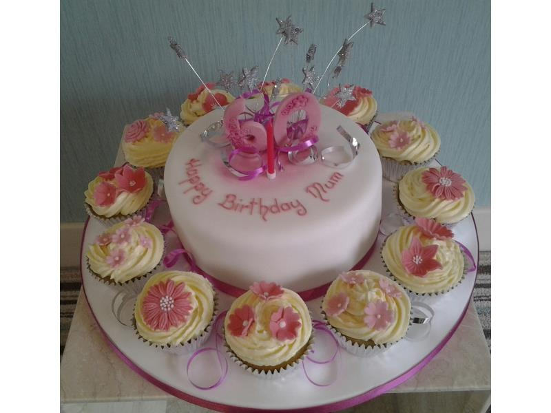 Mum's 60th for Anna in Cleveleys wwith cupcakes and main cake in vanilla sponge, with starburst and ribbons