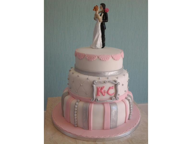 Classical wedding cake - 3 tiers in plain sponge covered in baby pink and silvered decorations