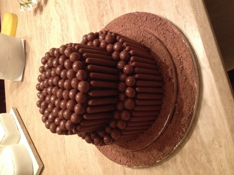 Chocaholic - Chris's birthday cake in Poulton made from chocolate sponge, maltesers and chocolate fingers.