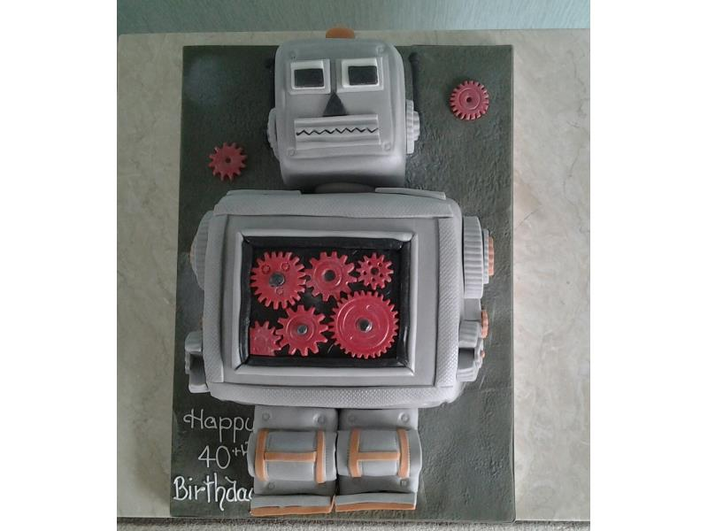 Robot cake in chocolate and orange sponge for Chantelle's partner in Blackpool