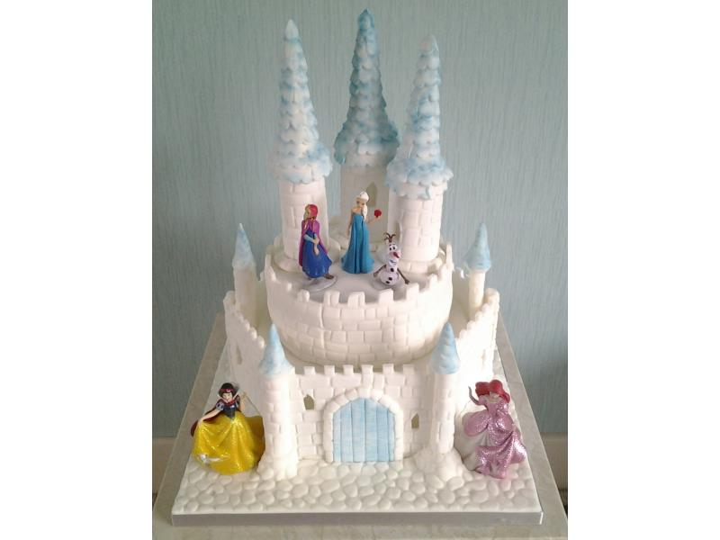 Disney Castle - combining Frozen and Princesses theme in plain and chocolate sponges with lights for Teddy in Blackpool