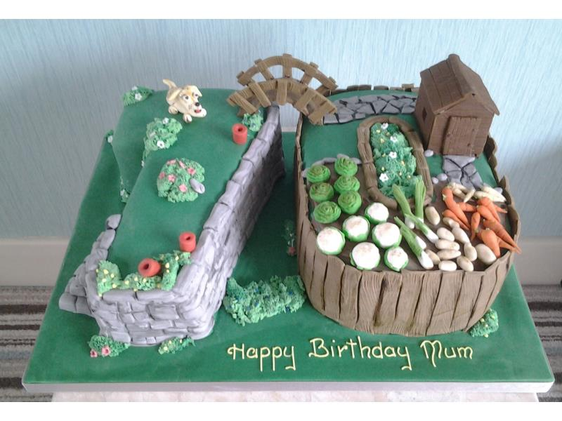 Gardening Mad - 70th birthday cake with all items handmade and edible for Cat in Lytham, made from chocolate sponge.