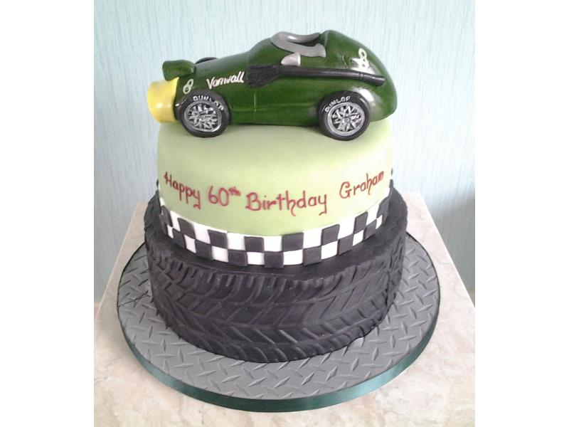 Vanwall - racing car on top of tyre cake for vontage car enthusiast Graham in Blackpool. Made in vanilla and chocolate sponges