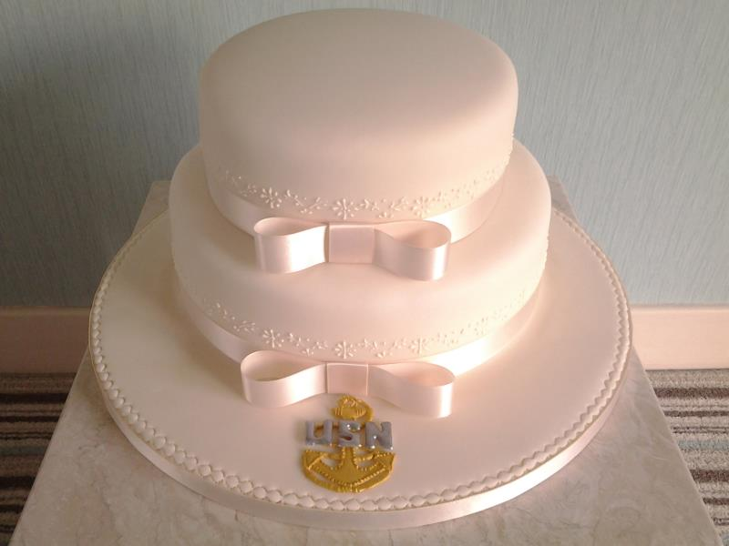 2 tier wedding cake, simple and classy for Swee Poh & Eric's wedding at Imperial Hotel, Blackpool. Bearing the crest of US Navy Chief Petty Officer