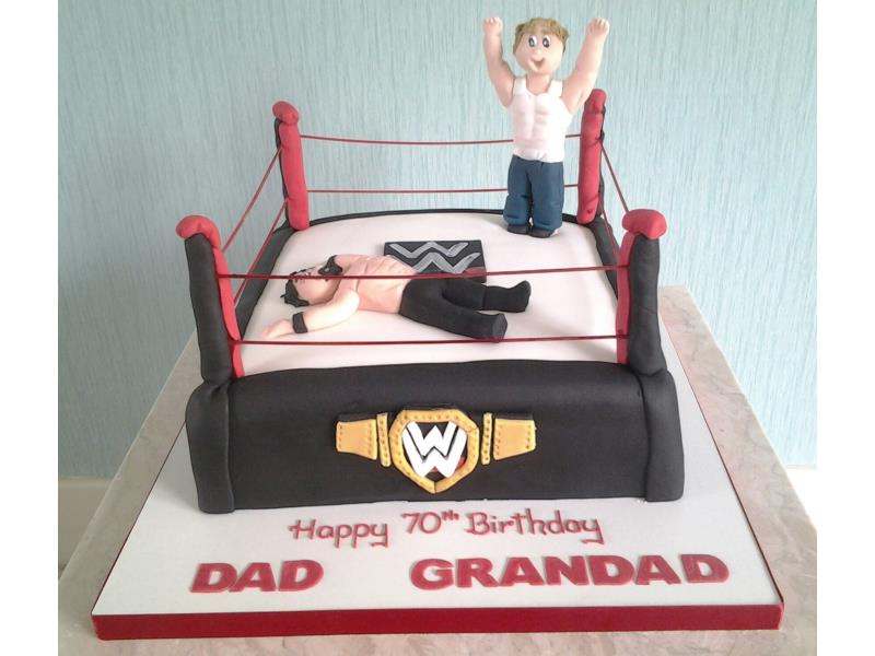 Wrestling ring and wrestlers for grandad's 70th in Preston. Made from chocolate sponge