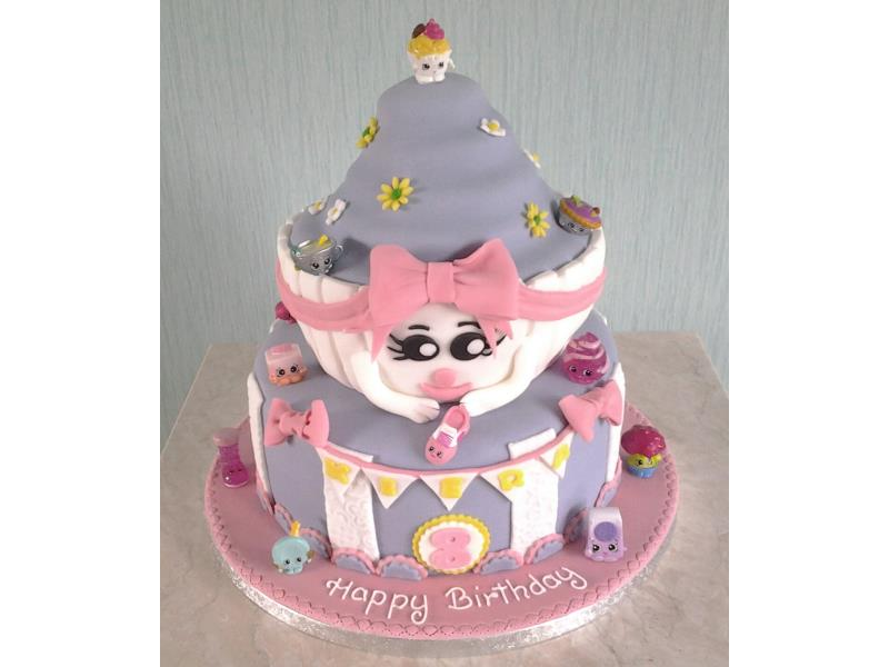 Shopkins themed 2 tier birthday cake including giant cupcake for Kiera in Staining. Made from cholcolate sponge.