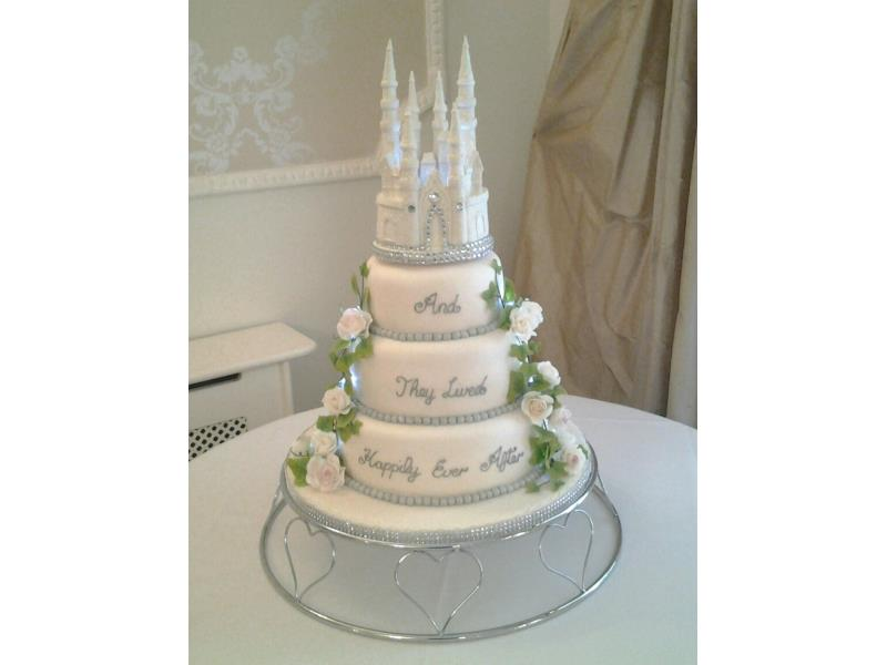 Disney themed wedding cake with castle in 3 tiers of lemon, vanilla and chocolate with orange sponges.
