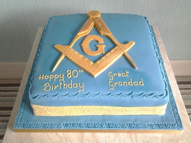 Freemason themed cake with compass and set square in chocolate sponge for David's 80th birthday in Lytham