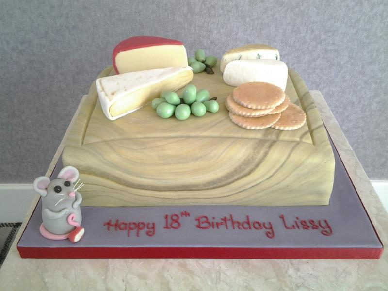 Cheeseboard with all items created from sugarpaste on a chocolate with orange sponge cake for Lissy in Blackpool