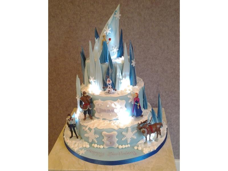 Frozen with lights - 3 tier vanilla sponge on the Frozentheme with lighs and shards for Olivia's birthday in Accrington