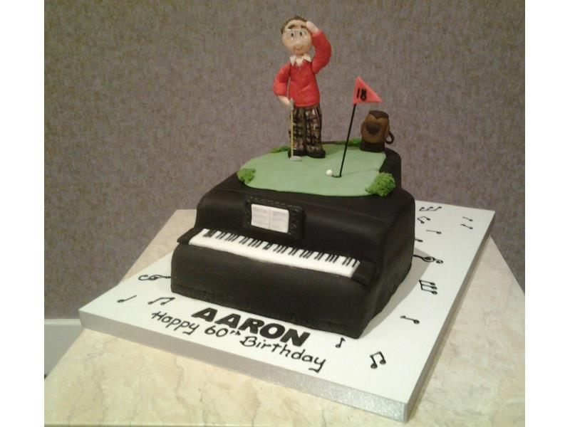 Piano - birthday cake in chocolate with orange sponge for piano playing golfer Aaron in Blackpool