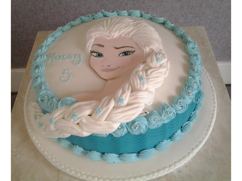 Elsa head and shoulders portrait hand painted on a chocolate sponge cake for Kacey in Blackpool