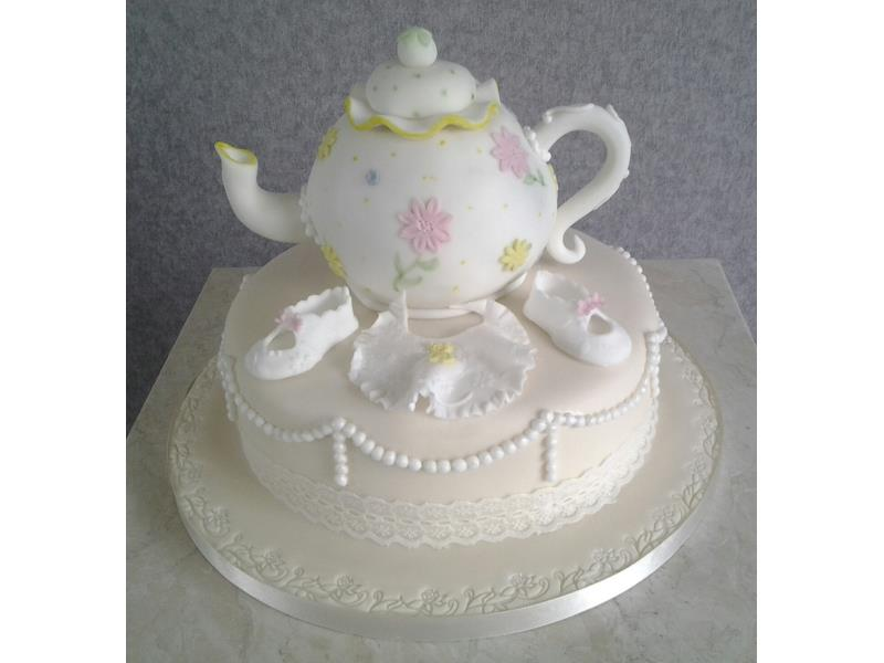 Teapot - baby shower showing teapot and baby bootees and dummy. Cake made from vanilla sponge for Lauren