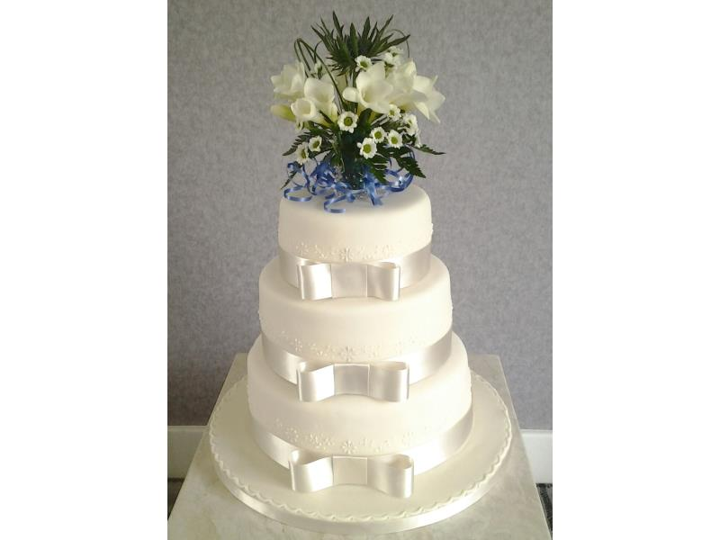Classic white 3 tier wedding cake in vanilla and chocoolate sponges and carrot cake for Sharon & Lewis at Park Hotel Blackpool