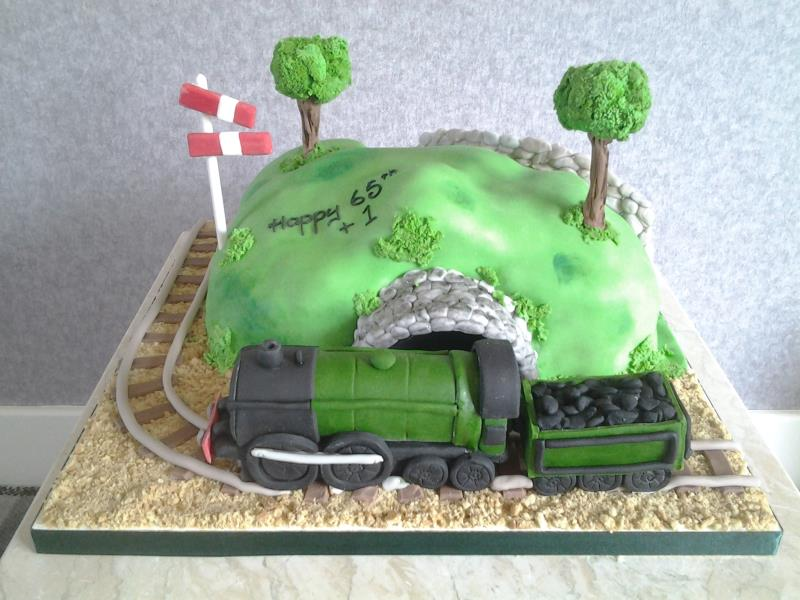 Model Railway - Poulton for Stephen's belated 65th birthday. Made from vanilla sponge and train hand modelled in sugarpaste
