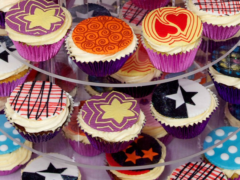 70s Theme - Close-up detail of cupcakes created for a 70s theme wedding reception