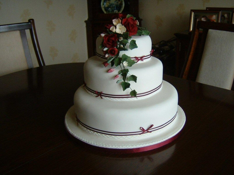 Ruby - 3 tier ivory sugarpaste wedding cake with freesias, roses and maroon banding
