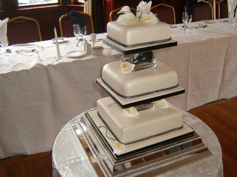 Natalie - 3 tier square ivory wedding cake with Cala lilys for Natalie, Blackpool