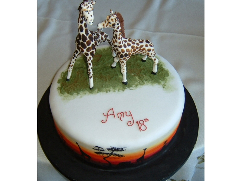 Amy - 18th birthday cake with modelled giraffes and an African sunset around the side