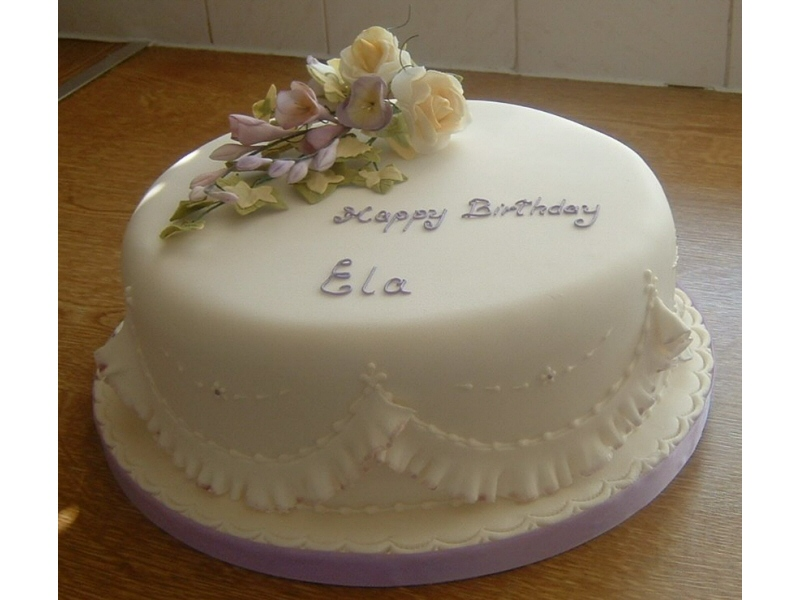 Ela - Cream and lilac birthday cake with freesia and rose handmade suger flowers