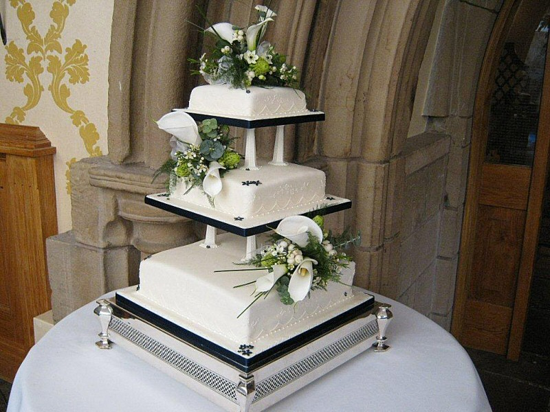 Kathryn - 3 tier square wedding cake decorated with arum lilies and snow berries for Kathryn and Ian in Chipping, Preston.