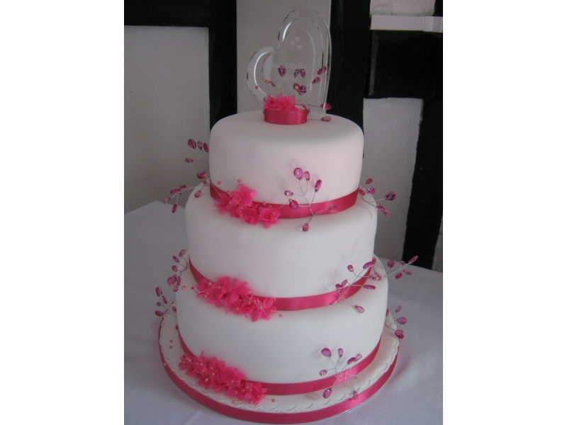 Kelley - Fuchsia pink 3 tier sponge wedding cake for Kelley of Darwin, near Blackburn.