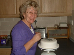 Photo - Sue Summers (me) working on a cake